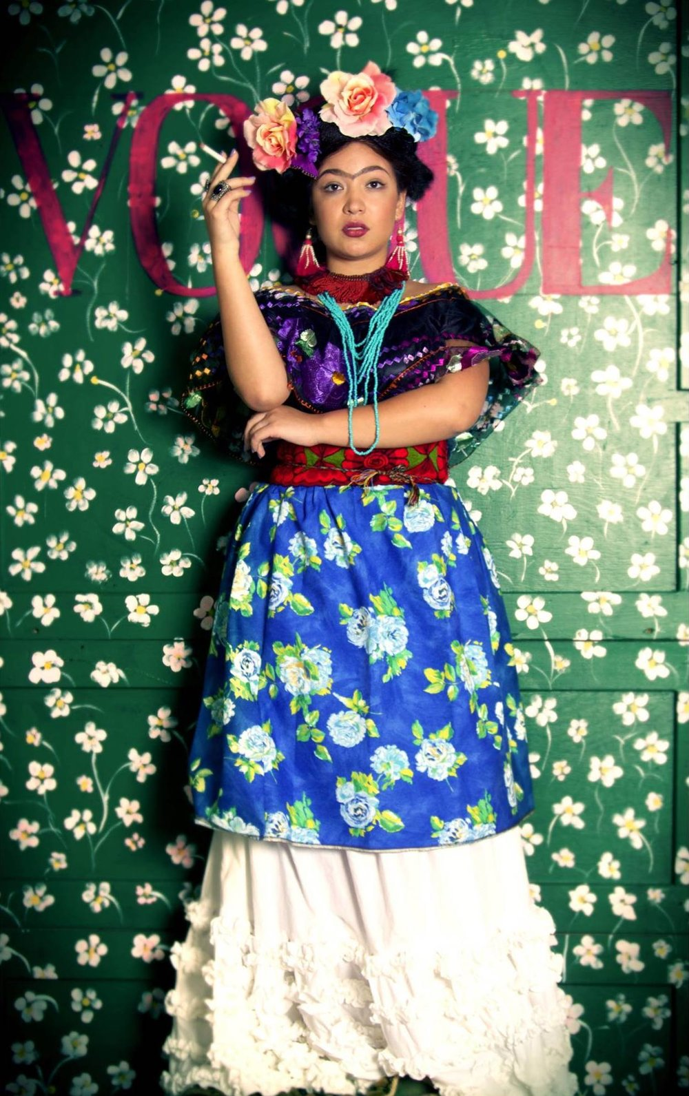 Frida photoshoot at the Boutique Photo Loft; 2016;  role: set design assistant, production assistant ; produced and designed by Shari Cornes; photographed by Amanda Pearon- lqbal; modeled by Dafne Lozano; makeup by Maria Dawley; Hair and headpiece by Francisco Chavez; Second hair by Tracey Preneur Bond (Agent Media); wardrobe by Shari Cornes, Audra Elizabeth, and Lubia Reyes; Styling by Lubia Reyes, Dafne Lozano, and Shari Cornes; Set design by Shari Cornes and Cokys Reyes-Arellano; curation and painting by Cokys Reyes-Arellano and team