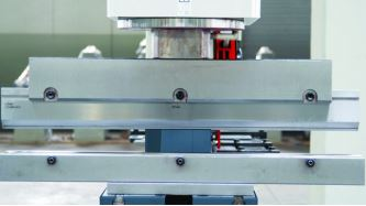 Optional Press Brake Attachment  It is possible to mount a bending attachment to the punch station. A large single vee or a four vee for thinner material is available.