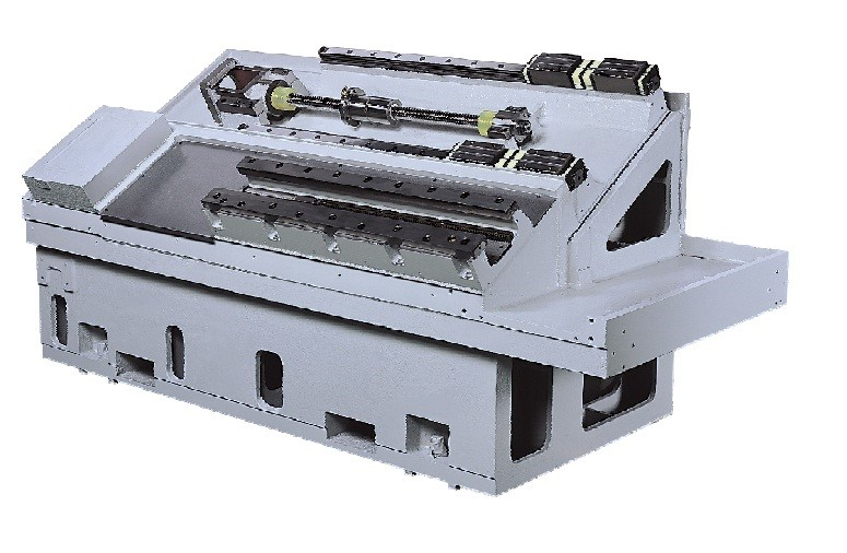 Machine Base  - High-quality cast iron base integrated structure contributes overall stability, rigidity and durability of the machine. - Strategically-ribbed, one body 30 degree slant bed design
