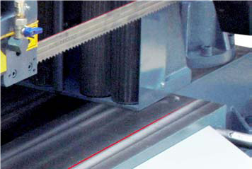 Laser Marking System (LM)  An awesome feature to have especially if cutting a lot of one off pieces at different lengths.  Also makes setting angle cuts much easier.  There is no need to lower the blade just above the work to set the cut length thus dramatically prevents accidents of lowering the blade into the material cause expensive blade breakages.