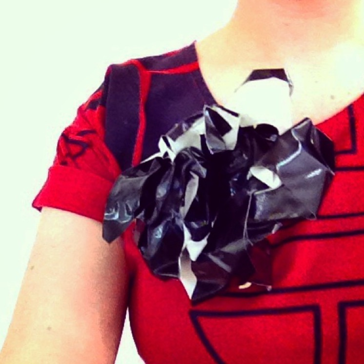 Gallery deinstall brooch - gaffa tape (2014)