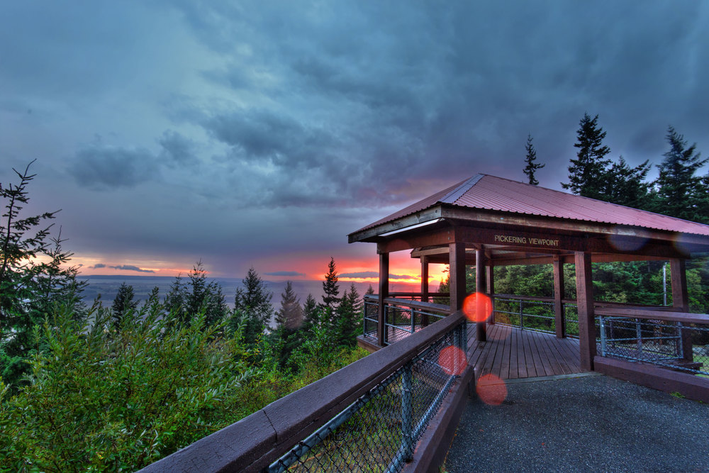 Pickering Viewpoint faces south across the farmlands of the Skagit River delta and over the towns of Conway and Laconner, Central Puget Sound, Camano & Whidbey Islands, all backdropped by the Olympic Mountains in the distance to the southwest. Photo © Peter Wheeler