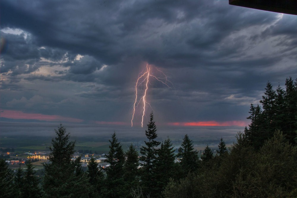 Lightning striking near Laconner at dusk - taken from Pickering (south) Viewpoint - Photo © Peter Wheeler