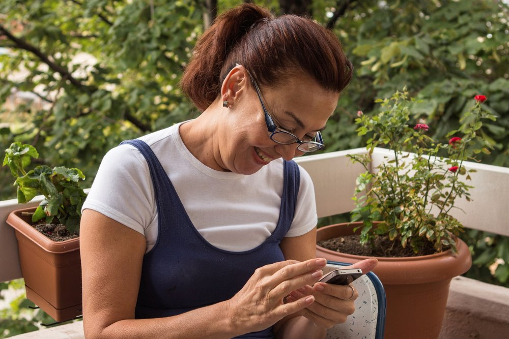 woman looking at phone iStock_000048887300_Full.jpg