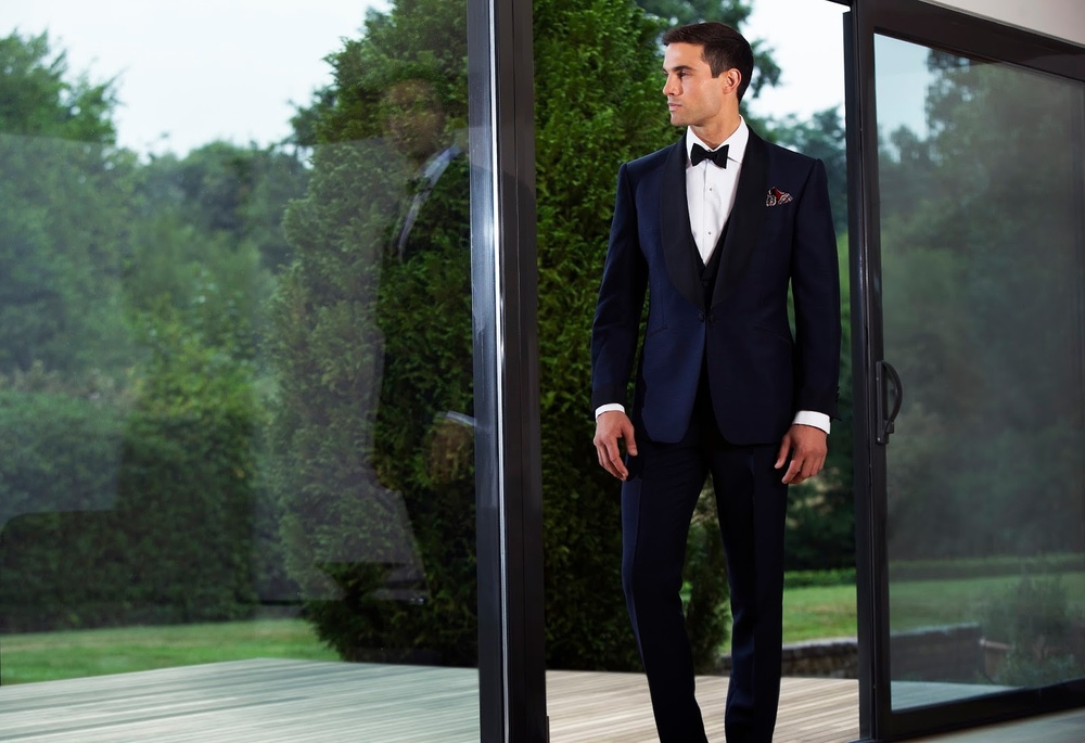 """A formal look from Chester Barrie's current collection — debonair pocket square deployed with """"reckless abandon."""""""