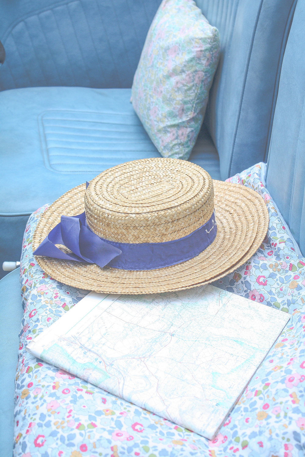 Obviously the best kind of travel is in Morris Minor with  Liberty print cushions  and a dashing gentleman