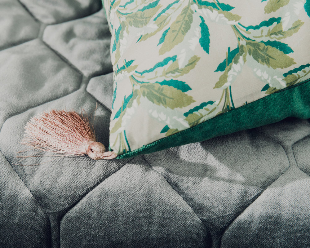 Small cushion in Liberty Print Palm Paradise with green velvet and pink tassel.