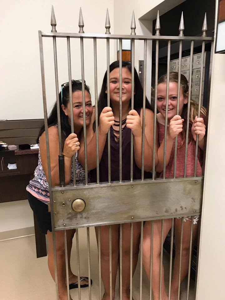 EEE ladies behind bars.jpg