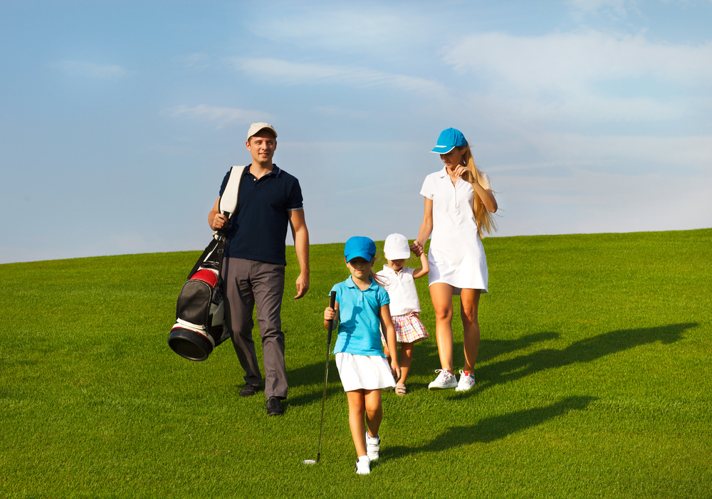 Family of four enjoying their golf