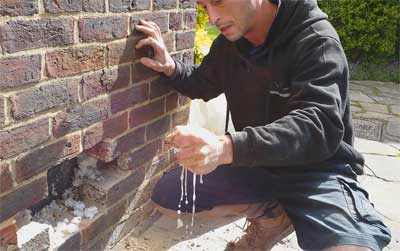 Damp cavity wall insulation