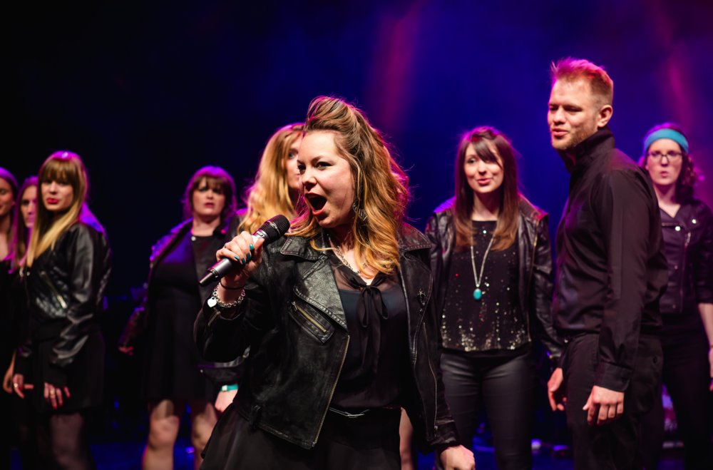 Kirsty on stage with the starling singers Photo: RICHARD DAVENPORT