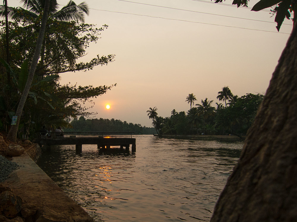 Sunset over the Kerala backwater from the shore.