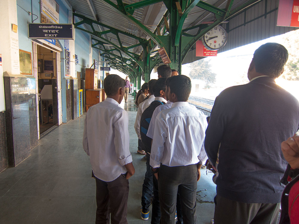 Some students waiting for their morning train to school.
