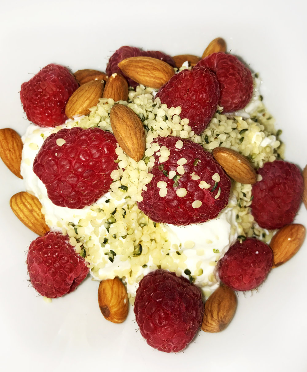 Greek yogurt, berries, almonds and hemp hearts make a delicious snack