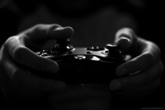 A player holds an Xbox One controller in their hands via Pexels