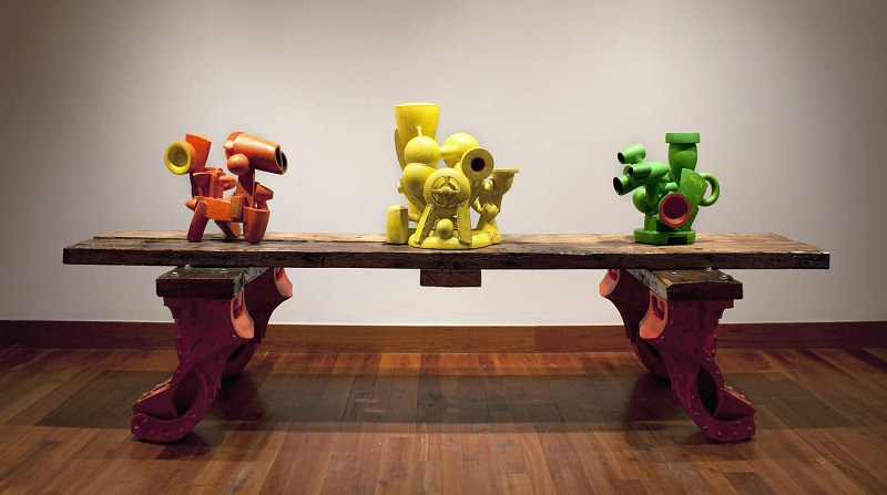 Doug Herren, Orange Industrial Ewer, 2012 (left); Yellow Vase Cluster, 2012 (middle); Green Ewer Form, 2012 (right); Long Industrial Table Stand, 2010 (bottom)