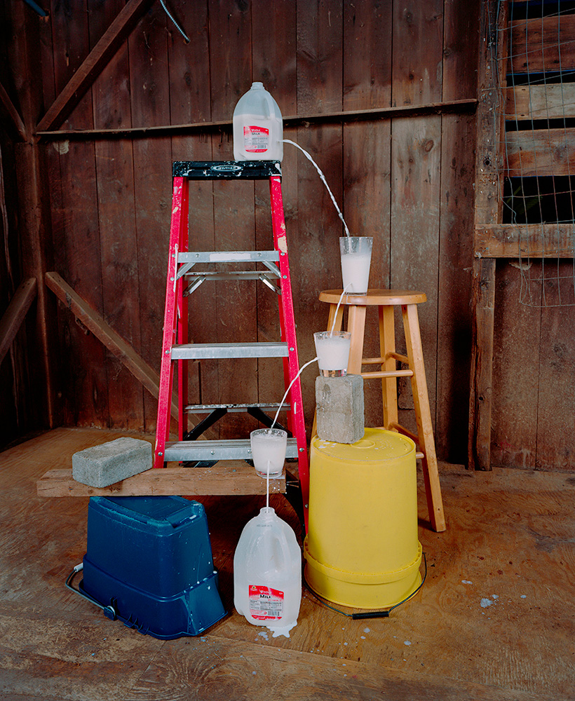TRANSFERRING A GALLON OF MILK FROM ONE CONTAINER TO ANOTHER