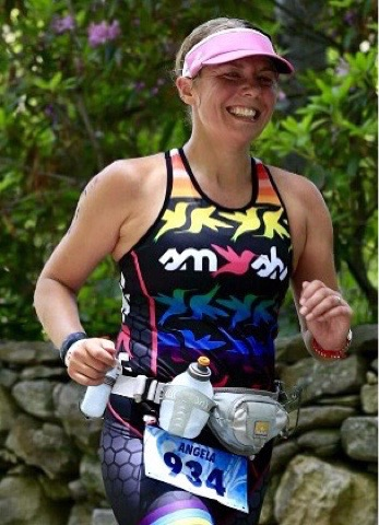 I even managed a smile on the 70.3 Quassy Run Course, thanks to endorphins!