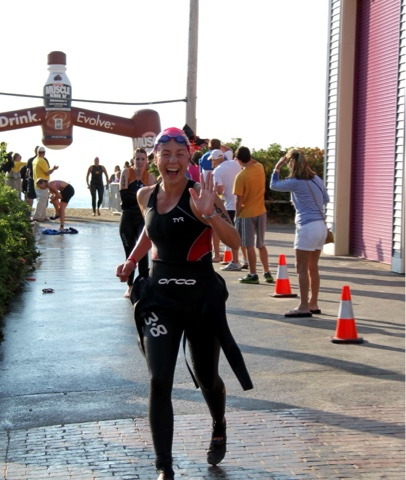 My post swim joy at the Rev 3 Maine Olympic Tri in 2012, it was a long run to transition, so it was nice to have on my socks to protect my feet.