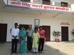 L to R: Bharat Kumar and Chitra Singh, Gopal and Kamala Singh, and their niece Mausam, in front of the school.