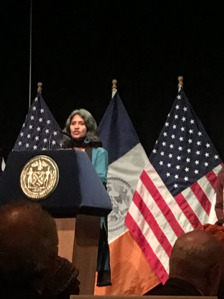 Sadhana's Sunita Viswanath delivering a reflection for NYC Mayor De Blasio's Interfaith Breakfast