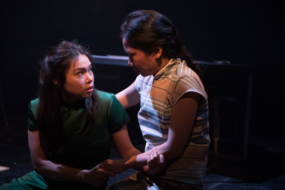 Helen ( Siu-See Hung ) and Lily ( Tina Chiang ) in '  Mountains: The Dreams of Lily Kwok  ' performed at the   Royal Exchange Theatre   (22 Mar - 7 Apr 18) ||  Photo by    Jonathan Keenan   - courtesy of the Royal Exchange Theatre.