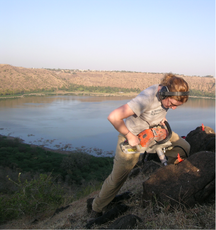 Former Harvard Ph.D. student Karin Louzada drilling basalts at Lonar crater, India.