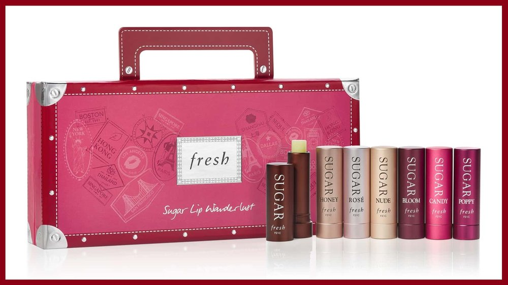 Fresh® ~  Sugar Wanderlust Lip Se t ($85 Value) $53 + 3 Free Packette Samples + Free  Gift Boxing  + Free shipping with $50 Order   What it is : A limited-edition lip treatment set with all the options, so you can nourish, protect and tint however you like.   What it does : This is the set to gift your lipstick-obsessed friend or to treat yourself with. Ranging from a non-tinted bestseller to honey nude to magenta pink, all seven of the moisturizing SPF lip balms are made with sugar, a natural humectant that seals in moisture. Each contains meadowfoam, blackcurrant seed and grapeseed oils, along with vitamins C and E to smooth, and soften, too.  Shades on shades on shades! This is the set to gift your lipstick-obsessed friend (or to  really  treat yourself). Ranging from a non-tinted best-seller to honey nude to magenta pink, all seven of the moisturizing SPF lip balms are made with sugar, a natural humectant that seals in moisture; meadowfoam, black currant seed, and grapeseed oils; and vitamins C and E to smooth and soften.   Set includes :  Sugar Rosé Tinted Lip Treatment Sunscreen SPF 15 (2.2g): Sheer rose. Long-lasting moisture. Protects.  Sugar Honey Tinted Lip Treatment Sunscreen SPF 15 (2.2g): Warm nude. Long-lasting moisture. Protects.  Sugar Bloom Tinted Lip Treatment Sunscreen SPF 15 (2.2g): Shimmery pink. Long-lasting moisture. Protects.  Sugar Nude Tinted Lip Treatment Sunscreen SPF 15 (2.2g): Blush nude. Long-lasting moisture. Protects.  Sugar Candy Tinted Lip Treatment Sunscreen SPF 15 (2.2g): Bright pink. Long-lasting moisture. Protects.  Sugar Poppy Tinted Lip Treatment Sunscreen SPF 15 (2.2g): Deep pink red. Long-lasting moisture. Protects.  Sugar Lip Treatment Sunscreen SPF 15 (2.2g): Long-lasting moisture. Smoothes. Protects.    Paraben-free; sulfate-free; phthalate-free  Made in the UK