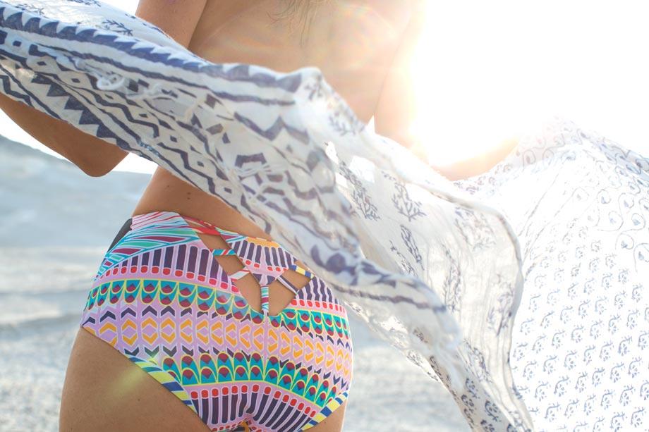 milos greece lifestyle travel photography lou mora bikini wind scarf flare backlit
