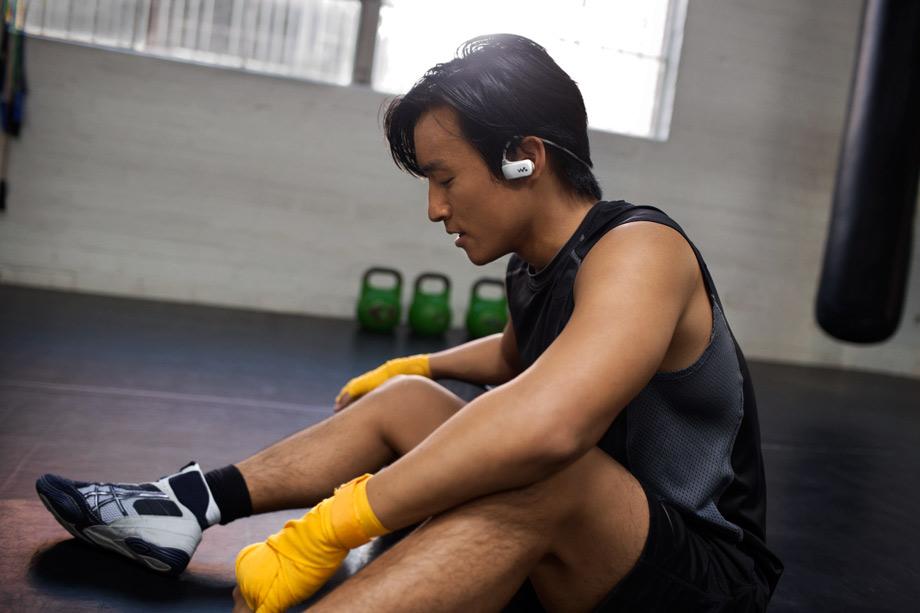 sony walkman male boxer taking a rest listening to music