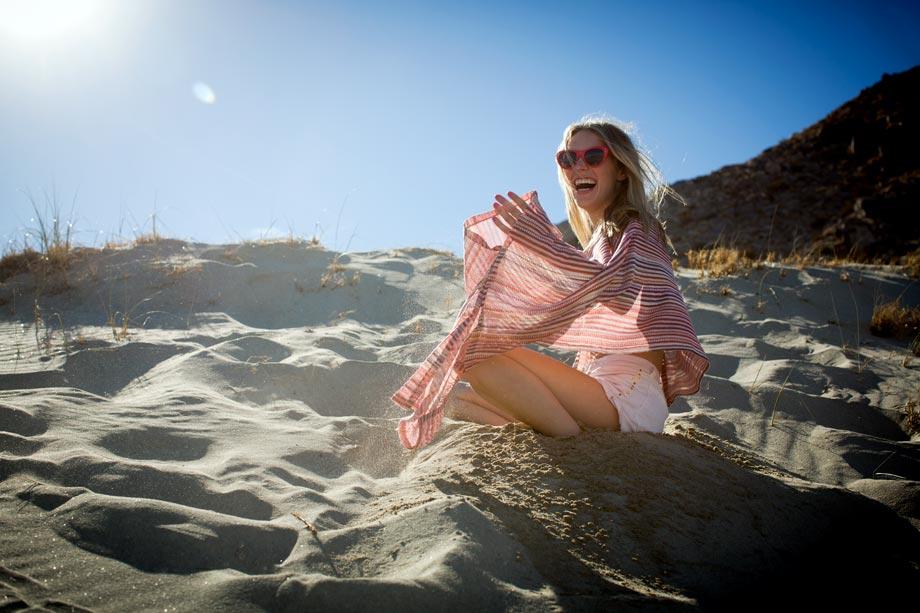 desert beach lifestyle girl laughing sand sunglasses sitting summer backlit