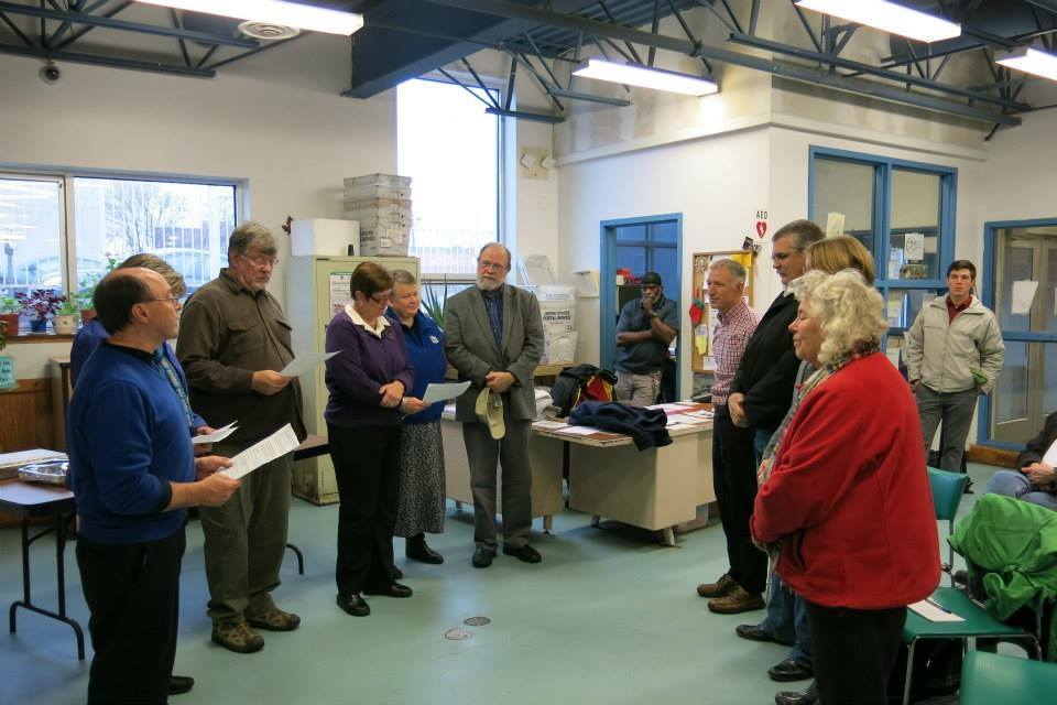 Praying with other local clergy for Duluth-area state legislators at CHUM drop-in and homeless shelter
