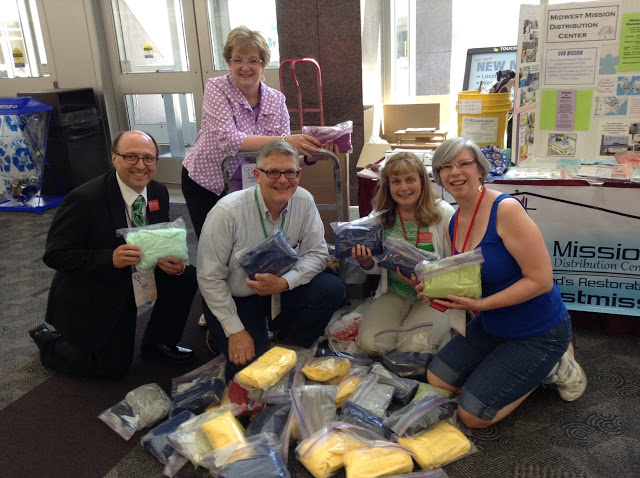 With UMCOR Health Kits and delegates/mmebers from First UMC, Duluth at the Minnesota Annual Conference, 2016