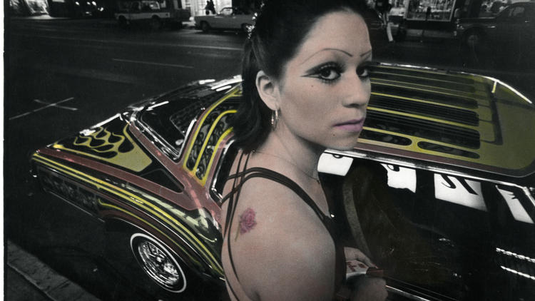 "In his later years, Ricardo Valverde took some of the early photographs he had taken and applied pigment to them, giving his work a hallucinatory feel. ""Boulevard Night,"" from 1979/91, includes one of his favorite subjects: low riders. (Ricardo Valverde / VPAM)"