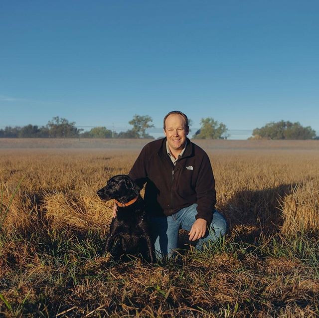 Michael Bosworth and his farm buddy, Drake posed in front of one of many of his rice crops at @rueandforsmanranch. Be sure to grab the latest issue of Edible Sacramento and check out this article which dives into some of the amazing and very significant innovations him and other leaders in the industry are making.i