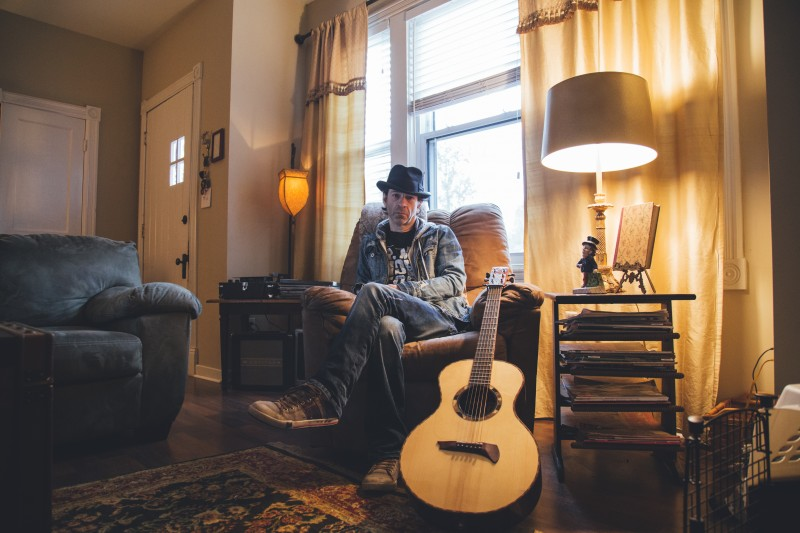 Travis Meadows with his custom Burchette parlor guitar - Photo by Slate + Glass