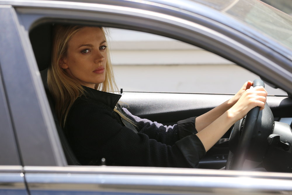 Kara (Bar Paly) waiting to pick up another young girl.JPG