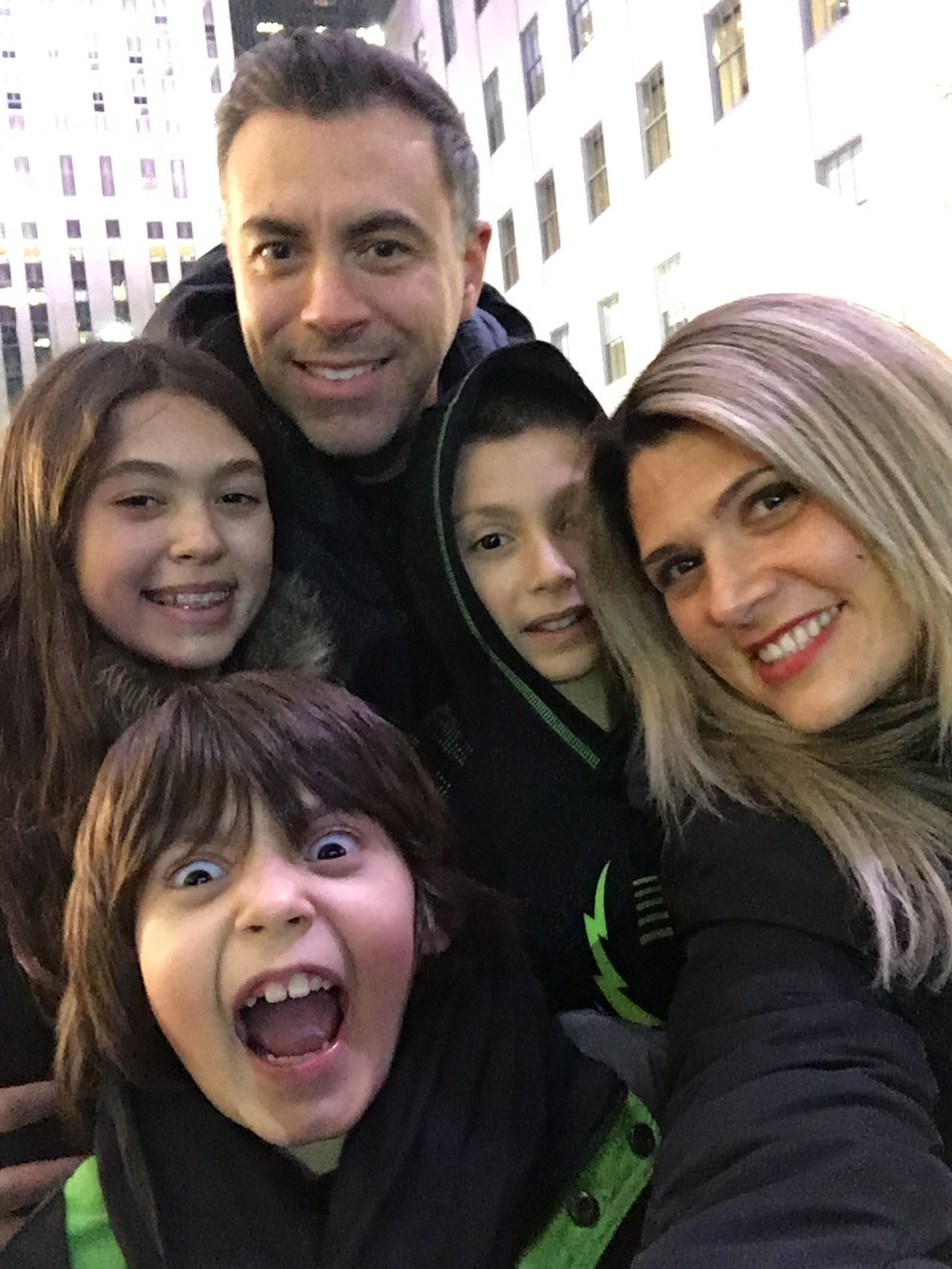 CHRISTMAS IN NYC - Here is our traditional family photo at Rockefeller Center Yup-Jude's facial expression sums it up for how I feel every December 1st.