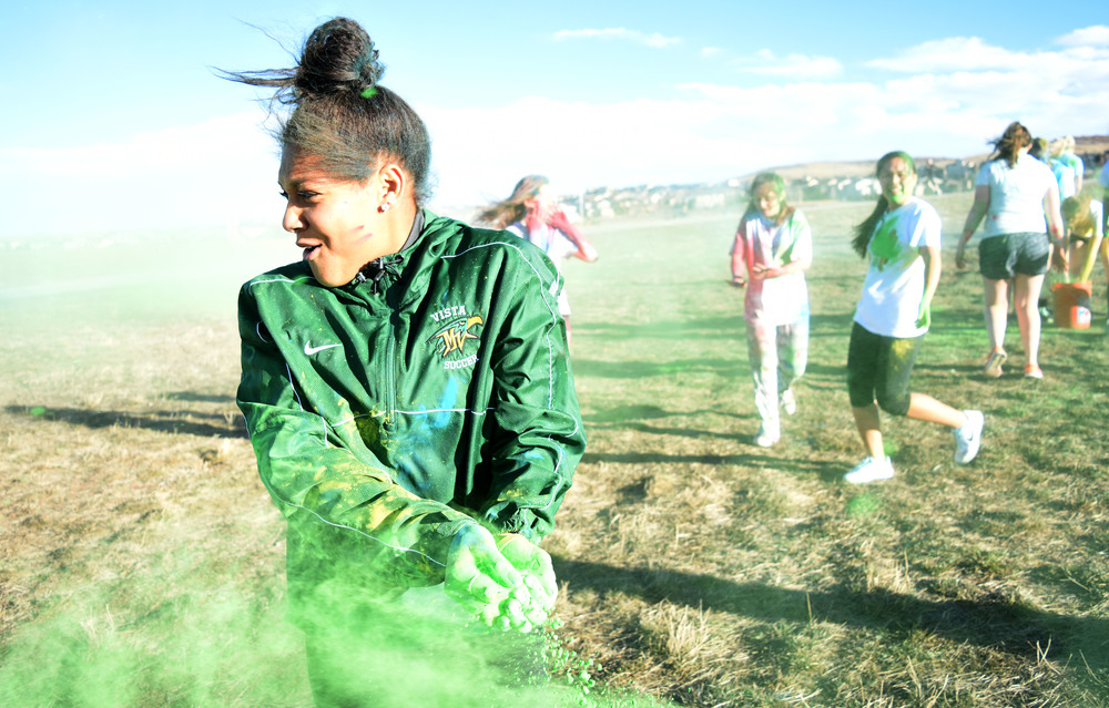 Senior Peyton Joseph turns her head to the side to avoid getting powder in her eyes as the wind picks up.