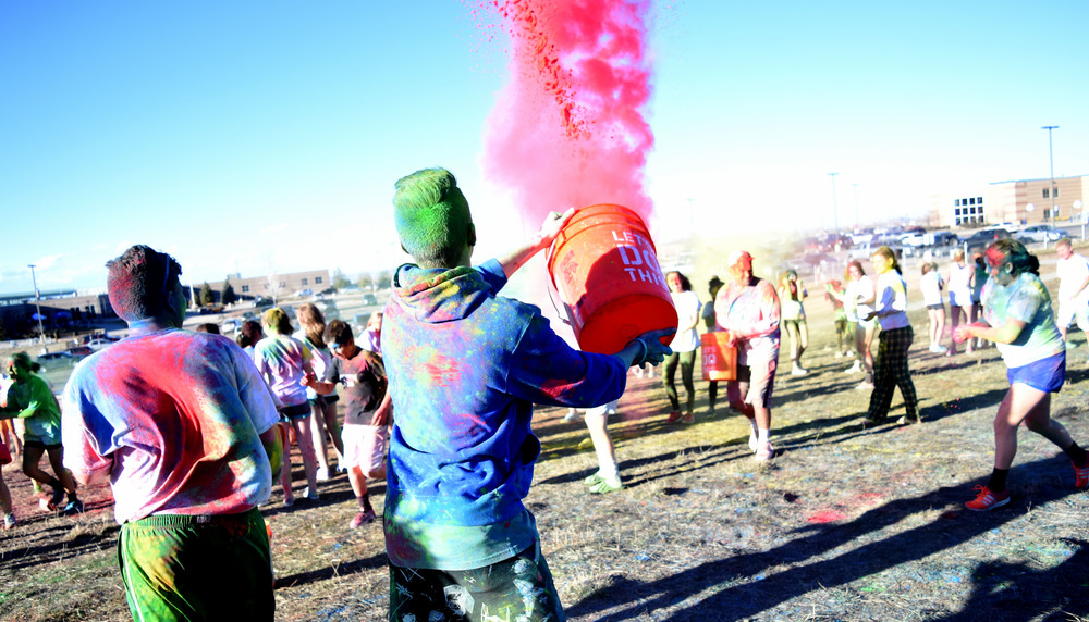 Student leadership showers the Wish Walk attendees in multicolor powder as the fight erupts.