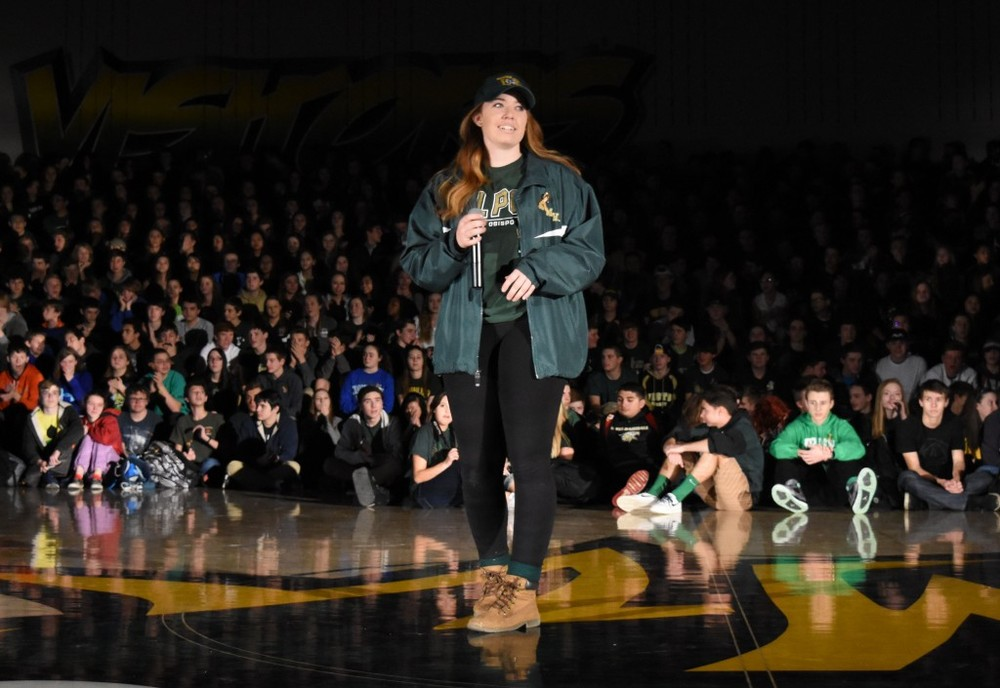 Senior Kat Cash speaks to the student body during the opening assembly of Wish Week. Cash and her colleagues in Student Leadership explained the plan for the week and riled up the crowd to commit their time and money to Marlee's cause.