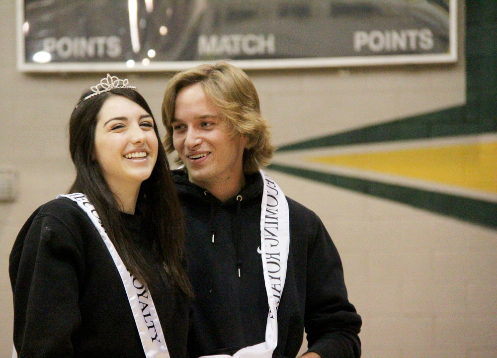 "Junior Keegan Petau looks at his longtime girlfriend Olivia Penna as they're crowned Homecoming Prince and Princess. Petau and Penna received ""most likely to get married"" as a senior superlative the following year."