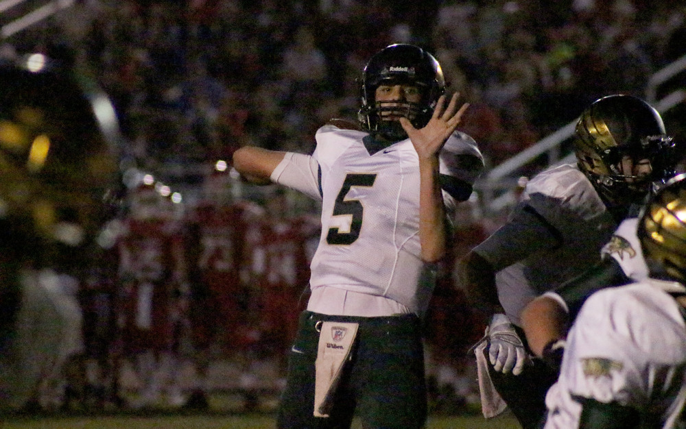 Junior quarterback Judd Erickson throws a pass during the Mountain Vista, Brighton football game. Erickson and his team defeated Brighton, 20-3.