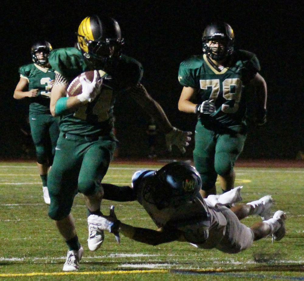 Junior Michael Rizzo runs in his second touchdown of the night against Mountain Range.