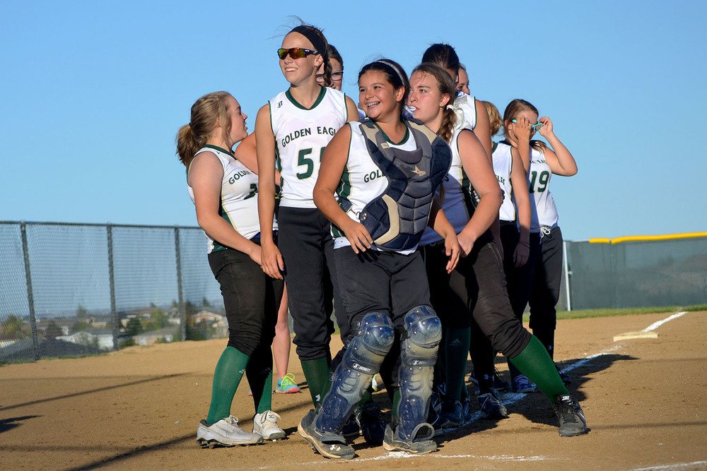 The level three softball team lines up to shake hands following a win against Douglas County.