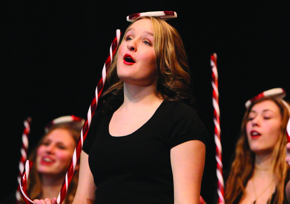 "Junior Grace Foster sings ""Candy Cane Lane"" during the winter choir concert. ""It was much different than what we've done in past years, but it turned out really well,"" Foster said. ""There were a lot of different choirs singing and singing together. As a whole, we sounded really good."""