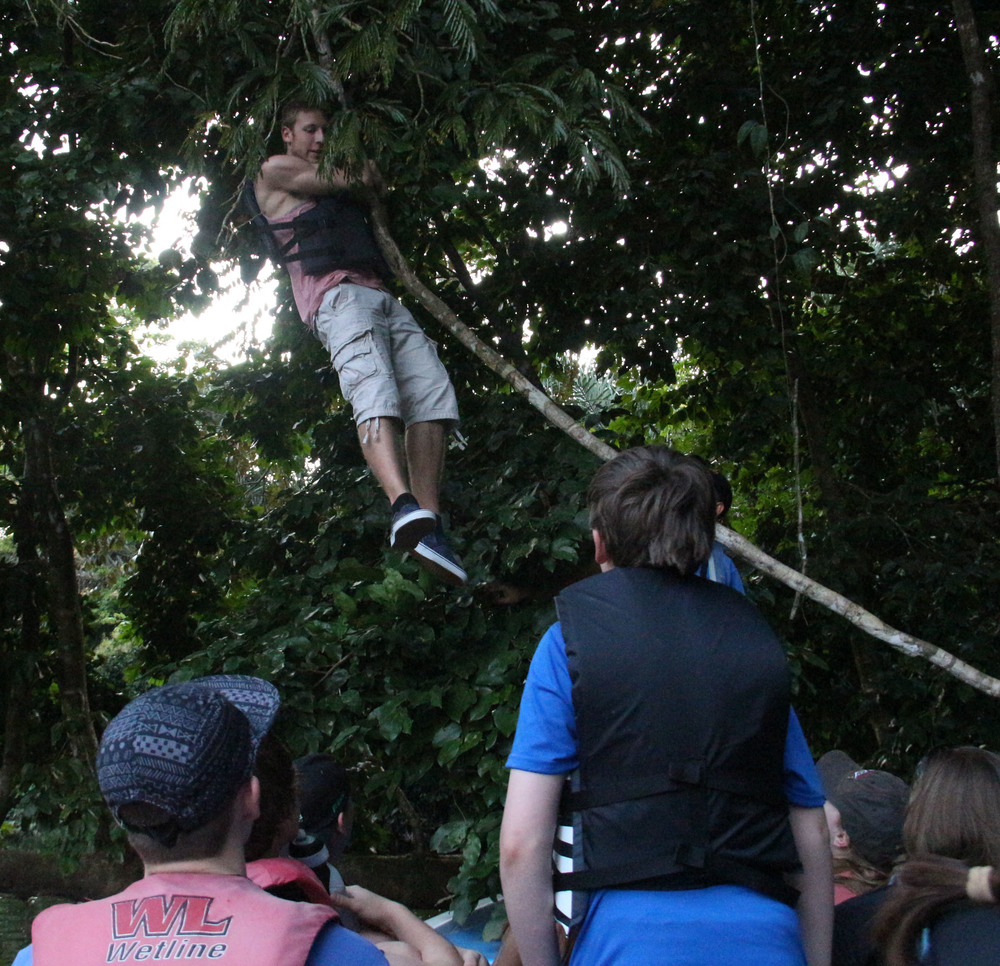 Junior Corey Bufus swings on a vine during a boat tour of the Pecuare Reserve.