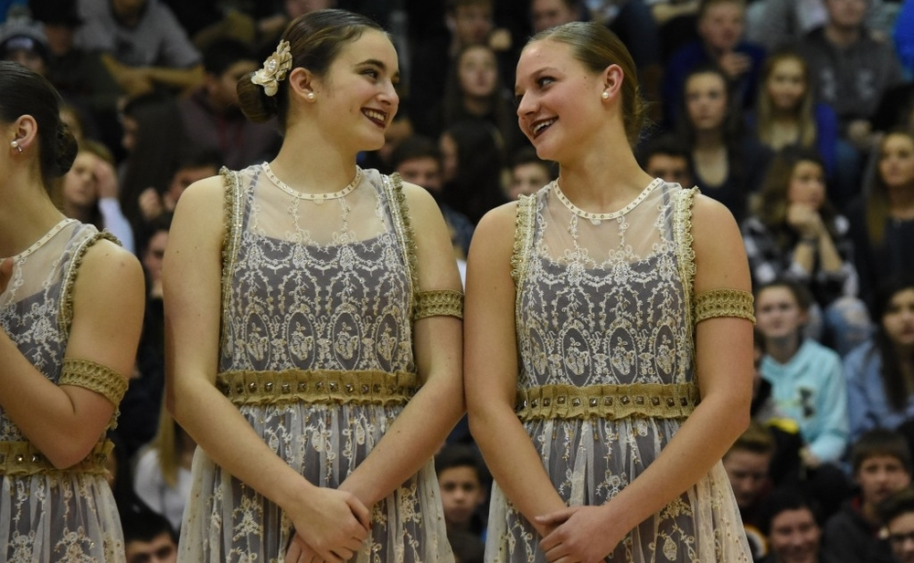 Senior co-captain Sarah Lissek and senior captain Allison Osowski exchange a glance moments before performing their winning jazz dance during the state championship assembly.