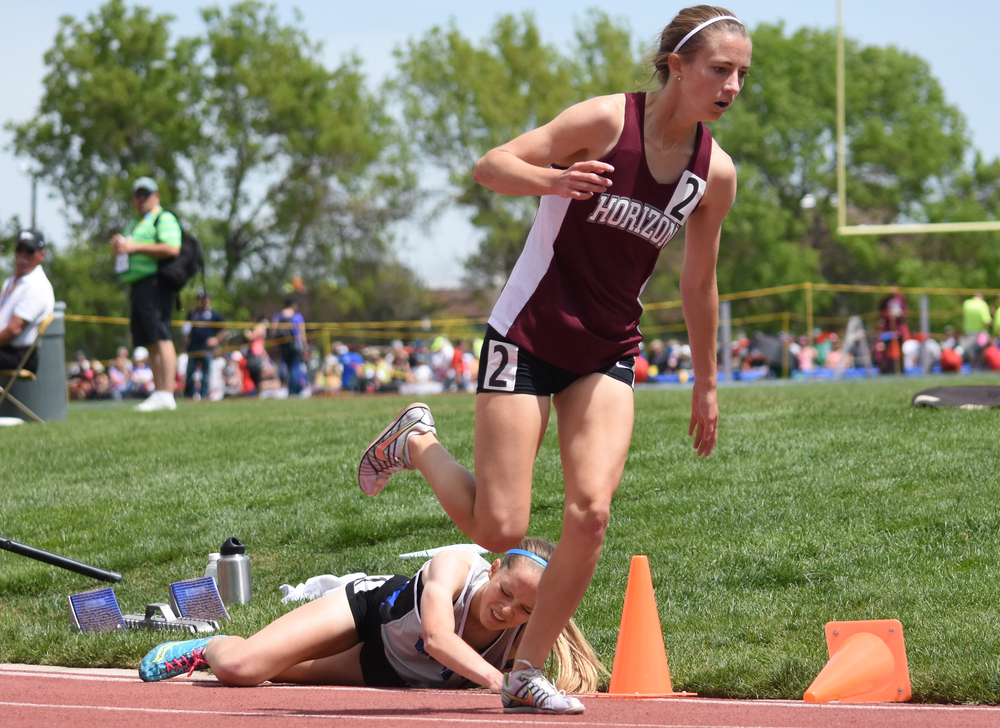 Horizon senior Megan Mooney continues running after tangling up with Grandview junior Brie Oakley. Oakley ended up taking the state title, as it was ruled Mooney tripped her around this corner. Published May 2016, Colorado Community Media