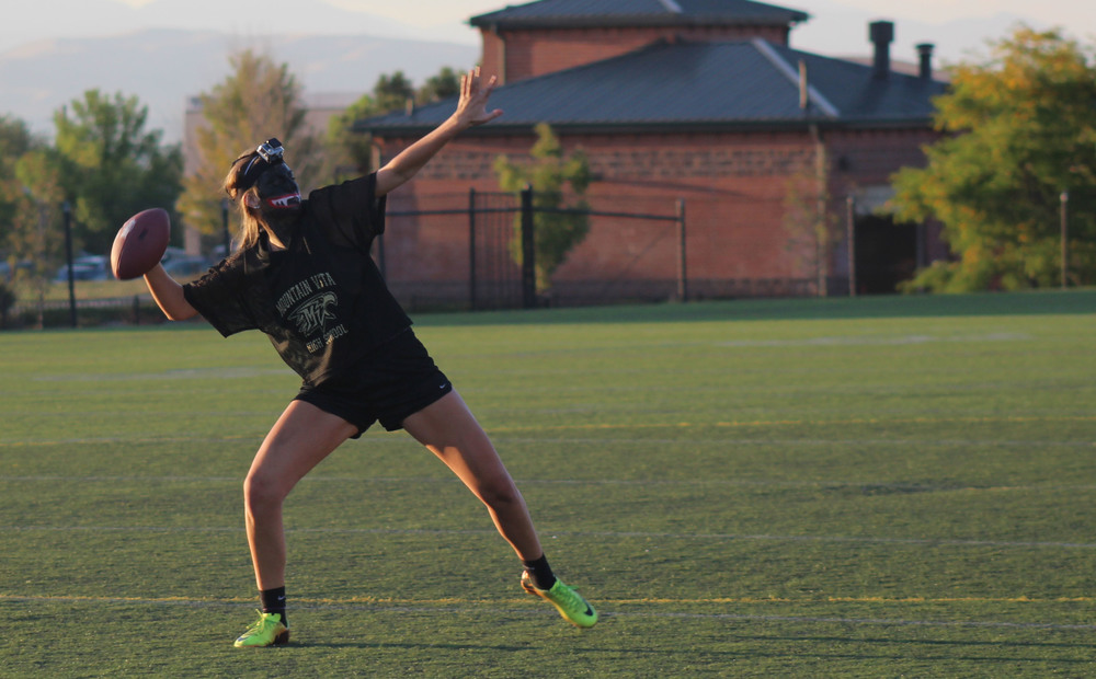 Senior Brooke Thomas warms up before the junior-senior powderpuff football game. Thomas and the seniors won for the second year in a row, making them the only class to win as juniors and as seniors. Published October 2015, Vista Now